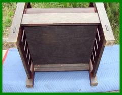 View of the bottom of the chair, showing the excellent condition of the bottom of the legs and the crisp original bevel of the feet.